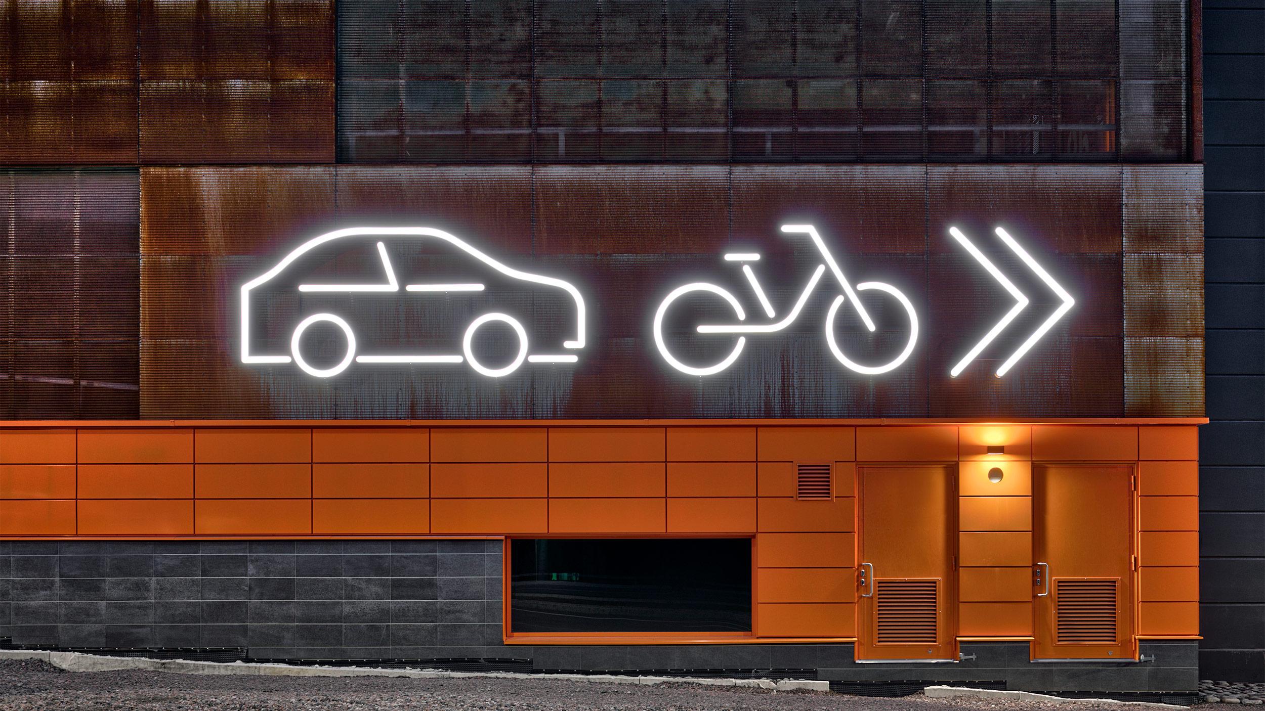 Valoputkista koostuvat opasteet näyttävät autojen ja polkupyörien paikat